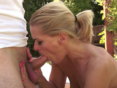 A milf is getting her cunt penetrated outdoors in the garden