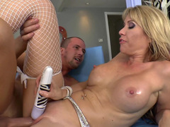 A blonde milf with a sexy smile is doing it with a horny dude