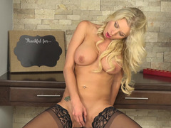 Blonde MILF with big tits wears stockings and plays with pussy