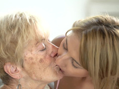 Young chick experiences lesbian sex with comely granny
