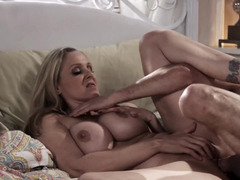 Blonde mommy in bed with a younger man for wild sex