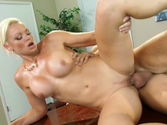 A blonde that has a shaved pussy is getting licked by her boss