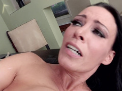 A milf that has black hair and large tits is getting on her knees to suck