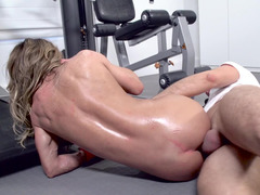 A babe with large tits is in the gym, getting her ass rammed