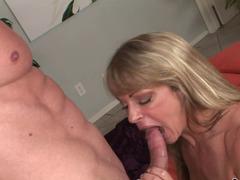 A hot milf that has large tits is getting her ass and pussy grabbed