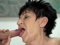 Mature dame enjoys oral sex with a young buddy and swallows cum