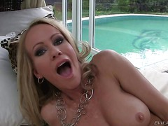 Blonde haired MILF Simone Sonay with hot boobs pulls her