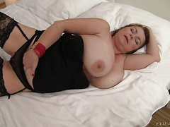 Mature BBW Ludmila B displays her huge natural juggs as