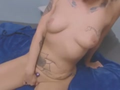Blonde MILF with inked body dildoing tight pussy