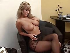 Sexy MILF in office puts on pantyhose and dress. Look how hot she can do it