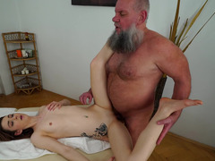 Old masseur with shaggy beard licks and fucks client's pussy