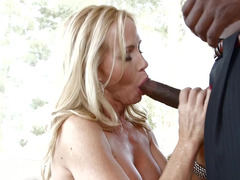 Blonde bitch is sitting on a big black meaty cock in this hot video