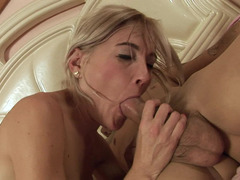 A hot milf is displaying her fucking skills in the bedroom in an erotic way