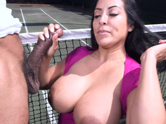 Woman with large boobs is playing tennis and is also licking dick
