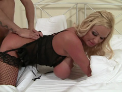 A fat blonde with a big ass is getting a dick placed inside her snatch