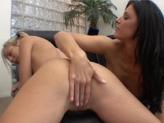 Two hot women hold and caress one another in the office