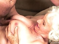 Busty granny Norma titty fucks a young boy