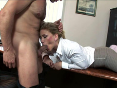 Hot blonde is getting penetrated deeply in her office
