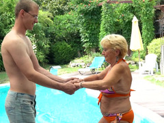 A fat granny gets undressed by the pool and she gets fucked there