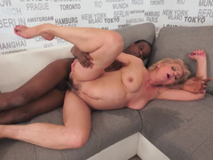 Hot granny likes black cock and she gets a big one inside her body