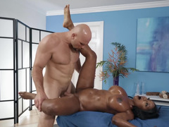 Relaxed black MILF lets masseur pound her pussy on table